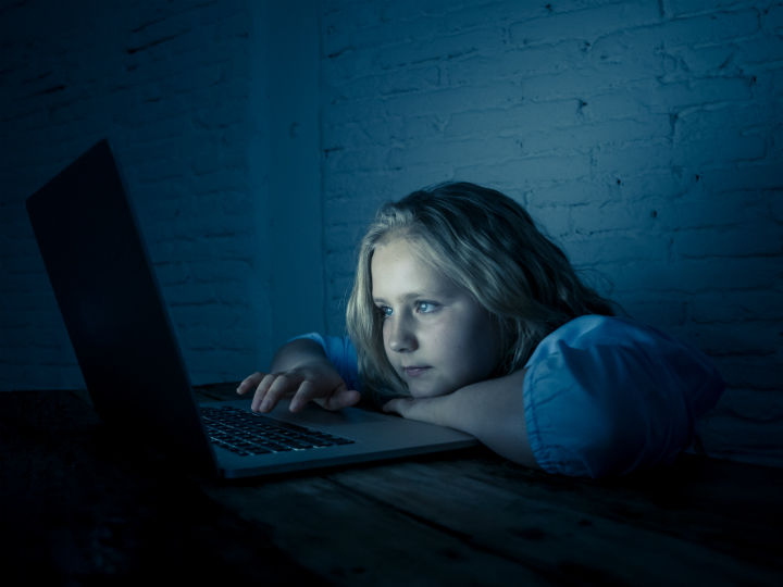 girl on laptop at night